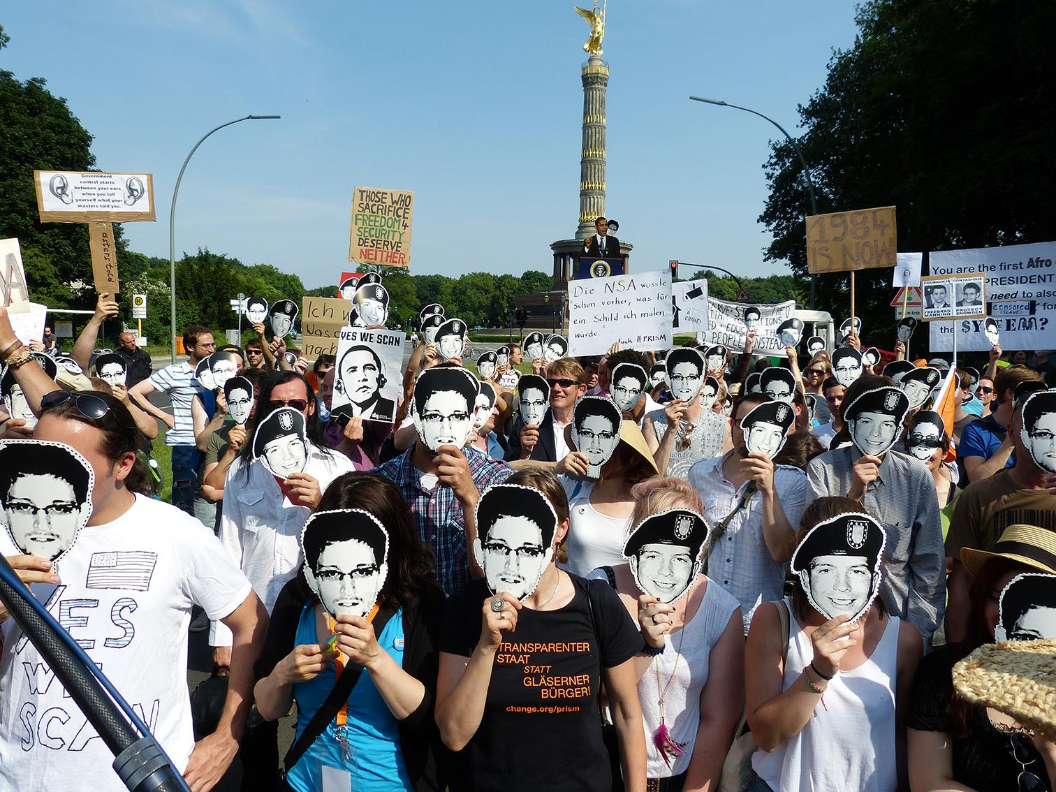 Demonstration against PRISM with Edward Snowden masks during Barack Obama's visit to Berlin, July 2013